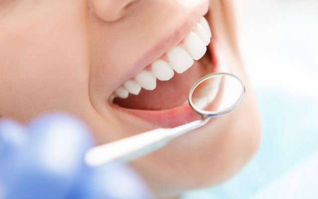 Professional dental cleaning with examination