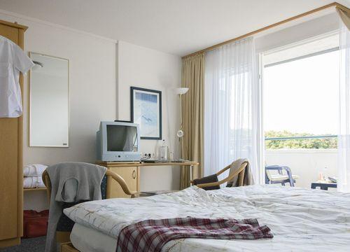 Double room standard with balcony (1/4) - Biohotel Strandeck