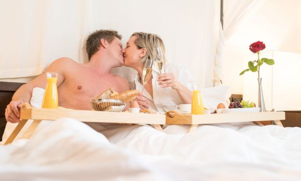 Breakfast in a romantic canopy bed